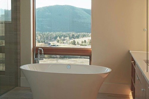 soaking-tub-in-front-of-window-in-Edgell-home