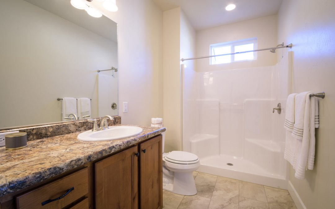 master bathroom with dual sinks and walkin shower